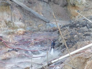 Mining pit: Where holes like this are left uncovered they quickly become a health hazard