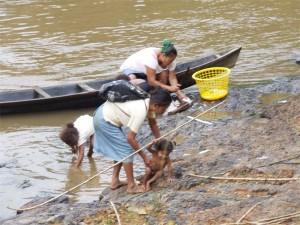 Pollution danger? Amerindian women washing at a creek