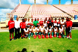 Members of the Golden Jaguars took time out for this photo opportunity with chief executive Officer of Digicel Guyana Limited Mark Linehan (10th from right) at the National Stadium, Providence yesterday. At extreme right back row is Technical director of the team Jamaal Shabazz. (Lawrence Fanfair photo)