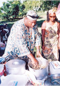 Dishing cook-up rice at the National Park on Emancipation Day 2006. (Stabroek News file photo)