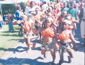 Little misses dance their way into the National Park on Emancipation Day 2005. (Stabroek News file photo)