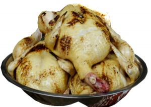Chickens, plucked and roasted. (Photo by Cynthia Nelson)
