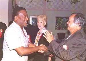 Sir Shridath greets Prime Minister Samuel Hinds.  (Stabroek News file photo)