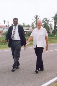 Stabroek News Editor in Chief and Chairman of the Board of Directors David de Caires (right) walks with AFC leader Khemraj Ramjattan during a protest outside the Caricom Secretariat in October  2007, against the withdrawal of government advertisements from this newspaper. (Stabroek News file photo)