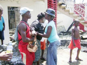 Pauline Rodney wife of the deceased being comforted by friends.