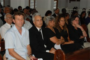 Doreen de Caires (centre) at yesterday's memorial service for Stabroek News Editor-in-Chief David de Caires at the Brickdam Cathedral. From left are his son-in-law, Mike Atherton; son, Brendan de Caires; daughter, Isabelle and sister Mary.