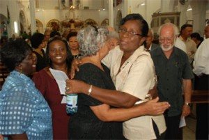 Doreen de Caires, widow of Stabroek News Editor-in-Chief David de Caires being embraced by member of staff Mary Evelyn.