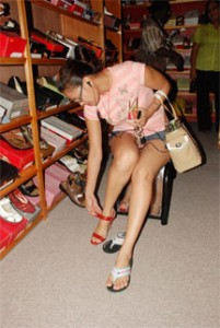 A customer tries on a shoe