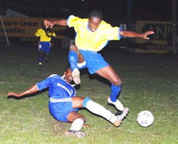 Pele's Okeniel Fraser skillfully evades a tackle by a Milerock defender. (Lawrence Fanfair photo)