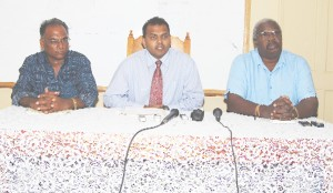 From left to right: Director of Sports, Neil Kumar, Minister of Culture, Youth and Sports, Dr. Frank Anthony and Permanent Secretary Keith Booker at the head table. (A Lawrence Fanfair photograph).