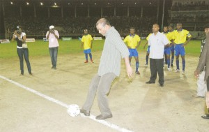LET'S GET IT ON! President Bharrat Jagdeo kicks the ball to start the final. (Lawrence Fanfair photo)