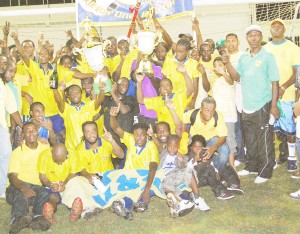 FINALLY! The triumphant Pele team and its supporters celebrate the victory. (Lawrence Fanfair photo)