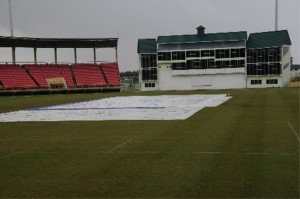 The pitch at the Guyana National Stadium is under covers, due to rain which prevented any play on the first day of the scheduled practice game between the national team and a Rest XI yesterday. (A Clairmonte Marcus photograph)