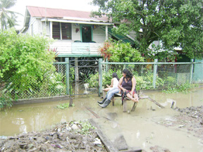 Sunday Lime: this was the most relaxing spot these ladies could find in their flooded environs yesterday.