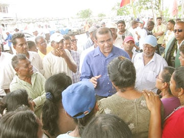 President Bharrat Jagdeo in a serious discussion with residents of Mahaicony Creek yesterday.
