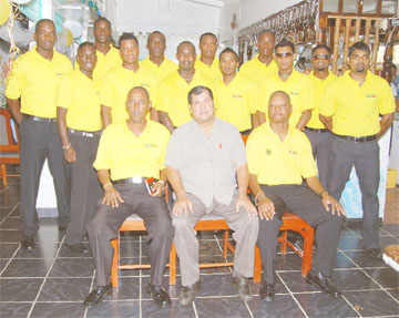 The Guyana team minus wicket-keeper Darwin Christian, prior to its departure for the  Cheddi Jagan International Airport (CJIA) yesterday. President of the Guyana Cricket Board (GCB) Chetram Singh, sitting, is flanked by Carl Moore, left and Albert Smith. (A Lawrence Fanfair photograph)