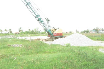 STALLED! Work has been stopped on the above site at Pattensen where the government is in the process of building a 50-metre, state of the art swimming pool boasting a 25-metre warm down pool and the first diving pool in the Caribbean for competition purposes.  According to Minister of Culture, Youth and Sport Dr. Frank Anthony, piles are required to strengthen the foundation of the facility which will cost around $50m.  Dr. Anthony has admitted in media reports that the piles were not catered for in the budget and as a result work on the structure has stopped. (Lawrence Fanfair photo)