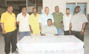 The newly elected executives of the Essequibo Cricket Board (ECB), from left: Carl Brandon (PRO), Edward Skeete (Competitions Committee Chairman), Prince Holder (Marketing Manager), Faizal Bacchus (Vice President), Linden Daniels (Secretary),  Sheik Fazal (Asst. Treasurer) and Brian Christiani (Treasurer). Sitting is president of the ECB Sheik Asif Ahmad. (A Clairmonte Marcus photograph)