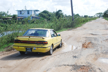 This vehicle in one of the huge potholes on the Cummings Lodge road.