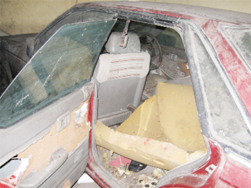 The stripped and  damaged Nissan  in the Brickdam Police Station compound.