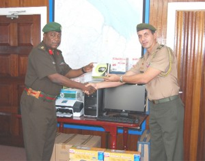 Colonel General Staff of the GDF, Colonel Mark Phillips (left) receiving the equipment from  Colonel Eudes Carvalho Dos Santos (GDF photo)