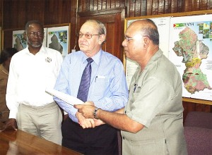 Acting Vice-Chancellor of the University of Guyana, Tota Mangar (second from right) with Chairman of the Guyana Geology and Mines Commission (GGMC) Board, Ronald Webster after the signing of a Memorandum of Understanding between the two entities for scholarships. Looking on, at left, is Commissioner of the GGMC, William Woolford.