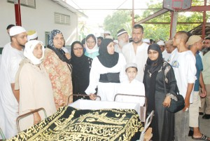 Members of Ayube Hamid's family at yesterday's last rites.
