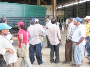 Rice miller Dindial Joree (centre) speaking to some of the farmers