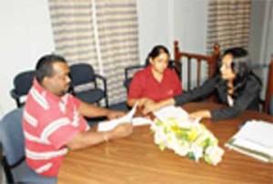 DFLSA officers interviewing a client