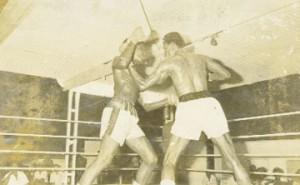 Lennox Blackmore, right, pounds Dick Tiger Greene.
