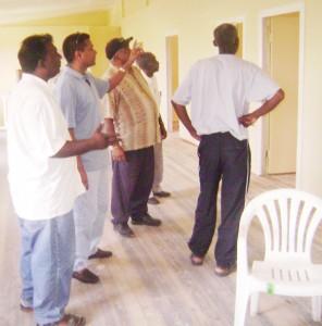 (From left) Essequibo Cricket Board (ECB) president Sheik Ahmad, Guyana Cricket Board (GCB) secretary Anand Sanasie, ECB vice-president Faizool Bacchus and former GCB vice-president Malcolm Peters during a tour of the ECB hostel. Backing the camera is secretary of the ECB Linden Daniels.