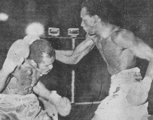 Kenny Bristol, right, on the attack against Pat Thomas.