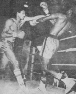 Winfield Braithwaite, left, on the attack against Derick `Teacher' Mc Kenzie in their fight for the welterweight title of Guyana. The fight ended in a draw.