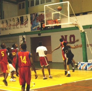 Part of the action between Bishops' High School and Charlestown Secondary at the Cliff Anderson Sports Hall on Monday. (Aubrey Crawford photo)