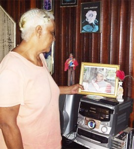 Norma Valentine looks at a photo of her late husband Irving Ferreira at her home recently.