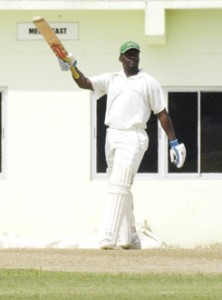 Guyana's Darwin Christian acknowledges the applause of his teammates, after reaching his maiden first class century against Jamaica at the Guyana National Stadium, Providence yesterday.