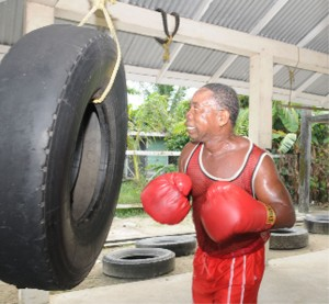 TIRING OUT! Clifford`Piggy' Griffith works out on the vehicle tyre in preparation for his upcoming fight against Cecil  Alfred. (Clairmonte Marcus photo)