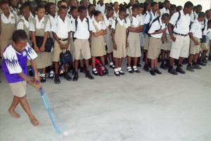 One of the participants at the session, displaying his dribbling techniques, whilst fellow students look on admiringly.