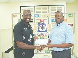 Daniel Fraser, left, Chairman of Region Eight receives the sponsorship cheque from George Mc Donald, Banks DIH Sales and Marketing Director.