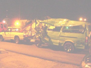The minibus being towed away from the scene of the accident.