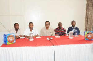 TAKING IT TO ANOTHER LEVEL! From left, NLE representatives Jamaal Douglas and Travis Shepherd, GABF president retired Col. Godwin McPherson and GABA secretary Bobby Cadogan addressing the media at the launching of the 2009 NLE Basketball Tournament. (Clairmonte Marcus photo)