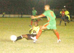 Mayor's Cup Action! This Milerock player slides and makes a clean tackle in the game against GDF on Friday at the GFC ground. GDF went on to defeat Milerock 2 – 1 to enter the quarter-finals of the competition. (Aubrey Crawford photo)