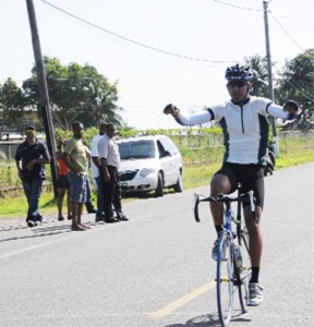 In this Clairmonte Marcus photograph, Darren Allen crosses the finish line unchallenged in the PNCR/NSC-organized Forbes Burnham memorial cycle road race yesterday.