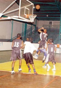 A GTI player goes up for a rebound during the final of the Schools' Mashramani basketball competition against President's College.(Aubrey Crawford)