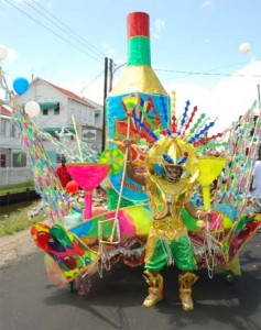 This costume of a champagne bottle represents 'celebration time' for Guyana and revelled under the banner of the Ministry of Culture, Youth and Sports when it took to the streets at yesterday's Mashramani Float Parade.   (Photo by Jules Gibson)