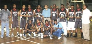 Minister of Sport Dr. Frank Anthony (center) and the victorious GTI team. Also in photo, Parliamentary Secretary Steve Ninvalle (extreme left) and Director of Sport Neil Kumar (extreme right) - (Aubrey Crawford photo)