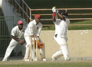 Narsingh  Deonarine  hits over the top during his first innings   143 against Trinidad & Tobago  (Aubrey Crawford photo)
