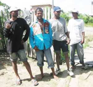 Mohanlall's brothers from right to left: Mohan, Chetram and Mahendra with Shiwpersaud's brother, Latchman after they returned from an unsuccessful search yesterday.