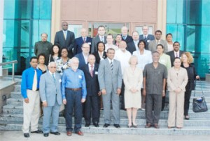 ACP-EU assembly: President Bharrat Jagdeo (fourth from right in front row)  poses with members of the Joint ACP-EU parliamentary assembly at the International Convention Centre yesterday. Also in the front row are Prime Minister Sam Hinds (second from right); Co-President of the joint assembly, Glenys Kinnock (third from right) and Foreign Minister Carolyn Rodrigues-Birkett (right). (Photo by Jules Gibson)