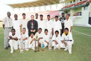 The victorious Corentyne under-15 team strikes a pose with acting president of the Guyana Cricket Board (GCB) Bissoondial Singh (standing fourth from left), along with coach Karl Vanier Jnr and manager Mark Lyte (standing right and left respectively). (Clairmonte Marcus photograph)